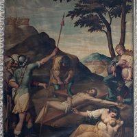 Gesù inchiodato alla croce, di Tiburzio Baldini (parete destra cappella crocifisso)